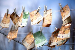 100 and 50 euro banknotes drying. Washed Euro paper bills. Drying euro on a string.Money laundering