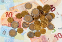 20, 10 and 5 Euros in paper money and various coins cents close up background