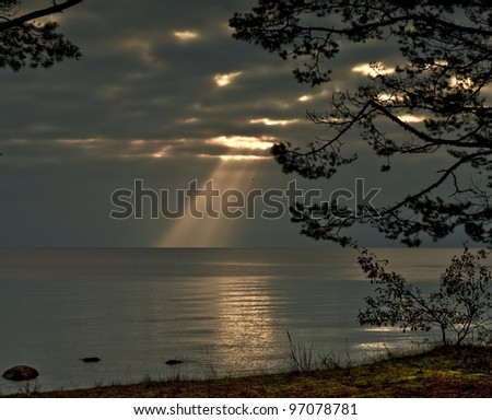 """And God said, Let there be light, and there was light"" (Morning silhouettes on the remote beach of Baltic Sea, Latvia, Europe)"