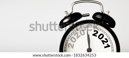 2020 and 2021 on black alarm clock  with copy space , Merry Christmas and Happy new year concept.