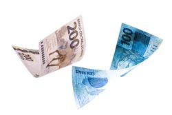 200 and 100 reais banknotes falling, two hundred and one hundred reais banknote from brazil on isolated white background, falling, financial crisis concept