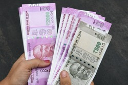 2000 and 500 rupee banknote India,The brand new Indian currency notes of 2000 and 500 rupees isolated on black. Business woman holding counting money. Success and got profit from business