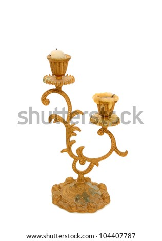 Antique dust  brass candle holder with pillar candle over white - stock photo