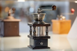 Antique manual coffee grinder with crank