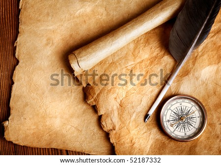 Antique paper scroll , quill pen and compass