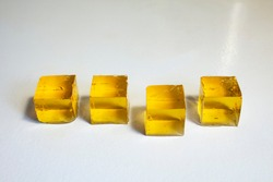 4 apple jelly cubes on a white background