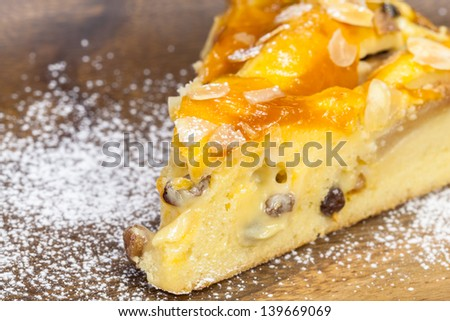 Apple pie.  Piece of fresh apple pie on a wooden  background with copy space. Close up. Shallow DoF