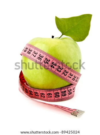 apple with measuring tape isolated on white - stock photo