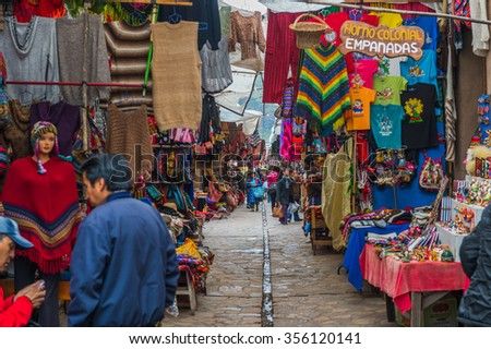 29 APR 2105 European Travellers walking and shopping local Peruvian product at Pisaq market, Scared Valley, Cusco, Peru #356120141