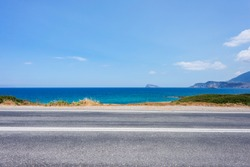 ?ar travel concept on Crete island, Greece. landscape of blue sea, sky, mountains, against the background of the road