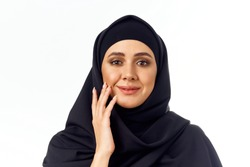 Arab woman in a veil on an isolated background portrait