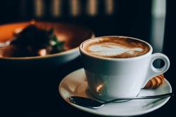 aromatic cappuccino coffee, photo with vintage filte
