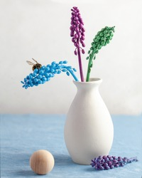 Art concept. Modern still life with colored flowers and a bee. The concept of summer, spring, fashion. Copy space.