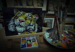 Art painting oil color , cute tiger  Lucky , paint brushes, palette ,in gallery ,from thailand
