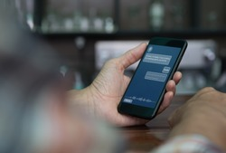 Artificial intelligence, Ai concept, casual man using mobile smart phone with chatbot application on screen in coffee shop, chat bot, social media, internet network communication
