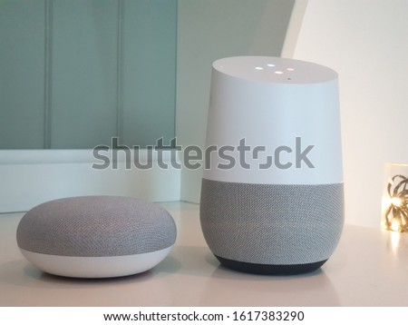 2 Artificial intelligent AI speakers and personal assistants compared in living room