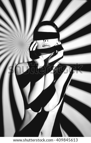 artwork portrait young beautiful sexy woman. model posing in light of projector. Black and white retro monochrome photography female mysterious silhouette. Old glamor retro fashion vogue photo shoot