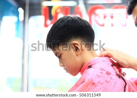 Free Photos Asian Cute Boy Trying To Sit Still For A Barber Thailand