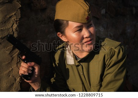 Asian girl soldier with a gun world war 2  victory day 1941-1945