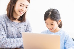 asian parent and daughter,laptop computer,