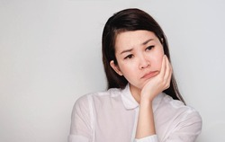 Asian women Sad face Stressed and thinking about something  with copy space,