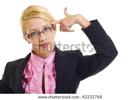 Attractive businesswoman in panic making a gesture as shooting herself - stock photo