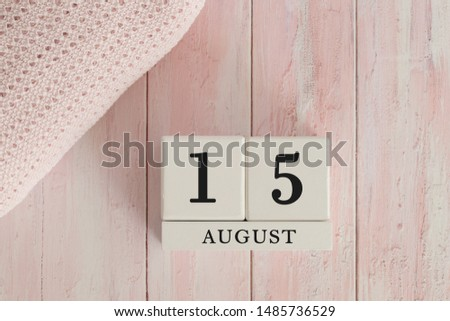 15 August Date on Cubes. Date on painted pink wood, next to baby blanket. Theme of baby due dates and birth dates. #1485736529