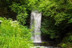 23 August 2019. The small fast running river at the Glencar waterfall sitein County Sligo Ireland. The glen and falls is a favourite place for country walks.