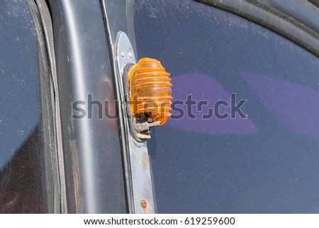 Auto turn signal with broken glass on an old car