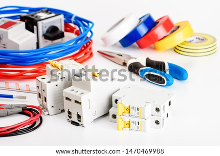 .Automatic circuit breakers, copper single core cable. Accessories for safe and secure electrical installation. Electrical equipment, protection and control, white background