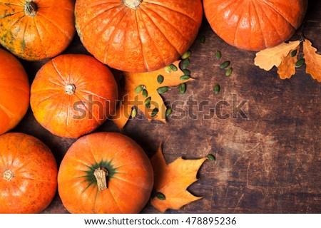 Autumn Pumpkin Thanksgiving Background - orange pumpkins over wooden table
