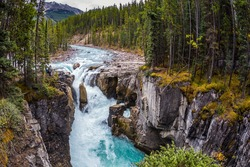 Autumn trip to Canada, Jasper National Park. The picturesque waterfall Sanvapta Falls. The concept of extreme and ecological tourism