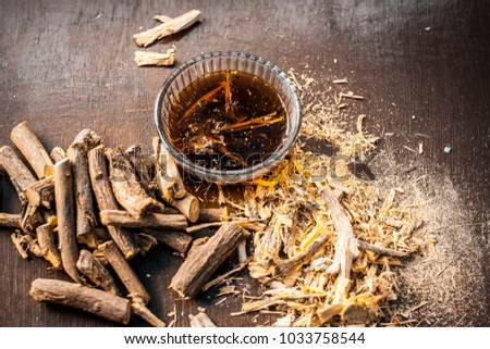 Ayurvedic herb Liquorice root,Licorice root, Mulethi or Glycyrrhiza glabra root and its powder with its tea for detoxifying the body, soothing spasms, easing menstrual cramps, raising blood pressure.