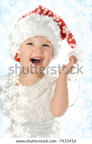 baby in red hat with snowflake