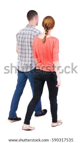 Back view going couple. walking friendly girl and guy holding hands. Rear view people collection. backside view of person. Isolated over white background.  #590317535