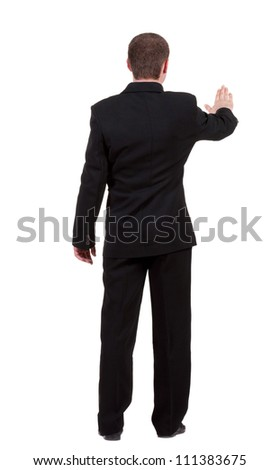 back view of Businessman . Young guy in black suit  watching. Isolated over white background. Rear view people collection. backside view of person.