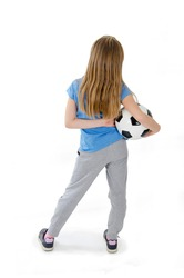 Back view of long hair teenage girl holding football, looking at wall. Rear view. Beautiful young girl holding soccer ball. Isolated on white background. Studio shot