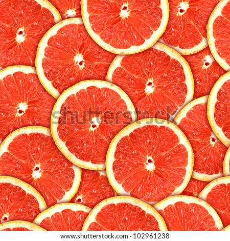 background of heap fresh red grapefruit slices. Seamless pattern for your design. Close-up. Studio photography.