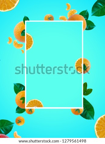 Background of yellow tangerines with blue color, contains leaves, tangerine helmets, for use of all kinds, especially arts #1279561498
