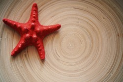 background with a place for an inscription with a red starfish on a wooden surface