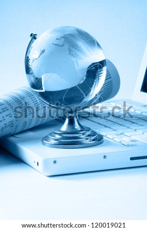 Background with laptop and blue globe