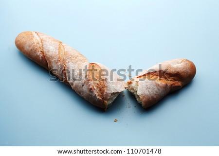 baguette tear into two pieces