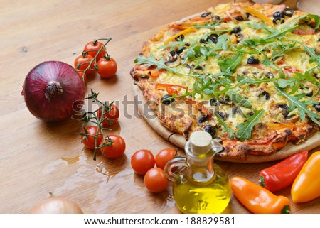 baked pizza with different ingredients