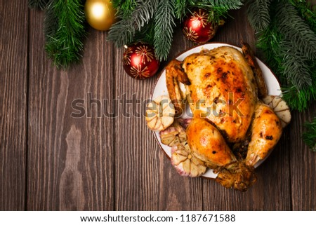 Baked turkey chicken is served on a plate on the background of a wooden table with a festive serving. New Year's Christmas concept. Flat layout. Copy space. #1187671588