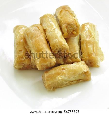 'Baklava'- an arabic sweet on a white plate.
