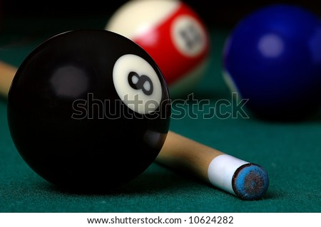 8 ball and a Pool Cue