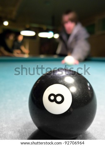 8-Ball and blurry person in background