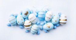 Banner. Blue and white easter eggs on a white isolated background. Geometry. Minimal easter concept. View from above. Easter card with copy space for text.