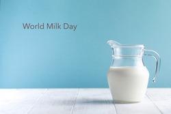 Banner. Jug of milk on a blue background. Lettering Milk Day. June 1st Copy space.