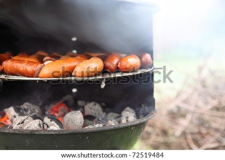 Barbecue view. Delicious grilled sausage, meat.
